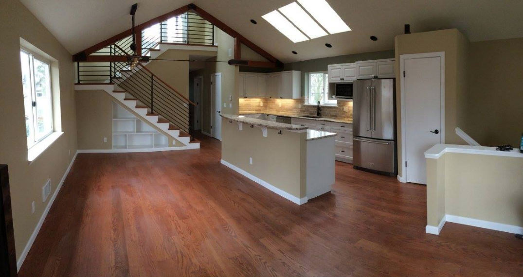 New Kitchen with open staircase to new roof deck.